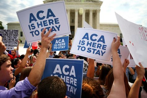 Demonstrators gater in support of the Affordable Care Act (2015)